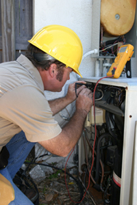 An air conditioning specialist repairing an AC unit